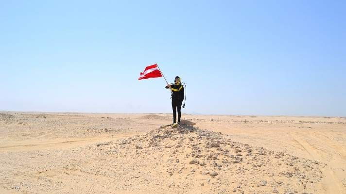 "Hope Ginsburg's ""Breathing on Land: Zekreet, Qatar II (Land Dive Flag),"" 2015. (Hope Ginsburg/Washington Project for the Arts)"