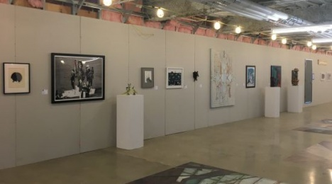 Exhibition works play off the industrial-chic atmosphere of the gallery space. Photo for East City Art by Eric Hope.