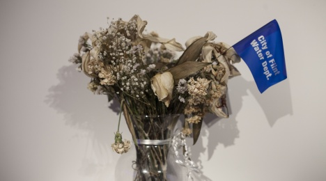 """Justin Poppe's vase of flowers with a pennant that reads """"City of Flint Water Dept."""""""